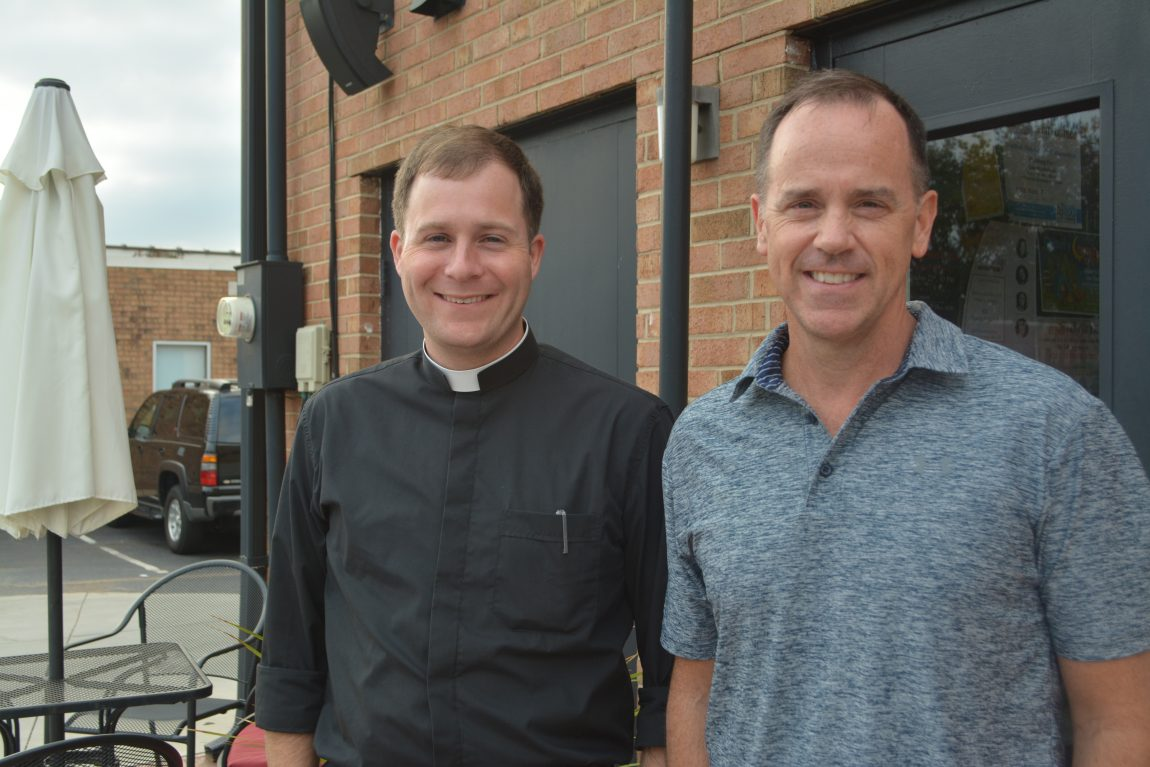 Father John Eckert and Pastor Rhodes Woolly